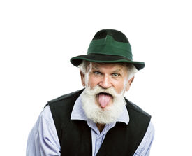 picture of sticking out tongue  - Portrait of old bearded bavarian man in traditional felt hat - JPG
