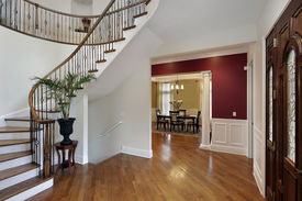 picture of entryway  - Foyer in luxury home with curved staircase and view into dining room - JPG