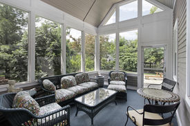 pic of screen-porch  - Porch in suburban home with wicker furniture - JPG