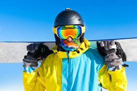 picture of snowboarding  - Snowboarder hold snowboard on top of hill close up portrait - JPG