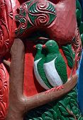 foto of maori  - Red and green Maori wood carving details with birds - JPG