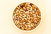picture of pinto bean  - macro closeup view of pinto beans kept in a bowl on a plain background - JPG