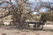 pic of wagon wheel  - Old wooden western pioneer days wagon on a ranch in the southwestern USA - JPG