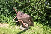 pic of wheelbarrow  - Garden wheelbarrow needed in a country house in the country for transportation of land and materials - JPG