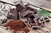 picture of cocoa beans  - Chocolate and cocoa bean over wooden table - JPG