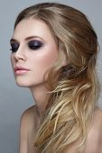 picture of messy  - Portrait of young beautiful blonde girl with stylish messy hairdo and smoky eyes make - JPG