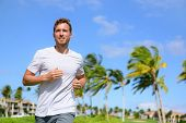 foto of jogger  - Healthy active man runner running in tropical park - JPG