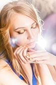 stock photo of minx  - Portrait of attractive blond girl with golden and make - JPG