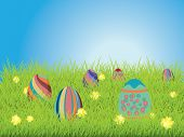 stock photo of laying eggs  - Easter eggs laying in green grass on a spring field - JPG