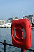 Постер, плакат: Quay side safety life preserver ring