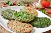 stock photo of veggie burger  - some different raw veggie burgers in a plate on a rustic wooden table - JPG