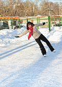 Girl On Winter Skate Rink