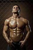 picture of nake  - the very muscular handsome sexy guy on black background naked torso - JPG