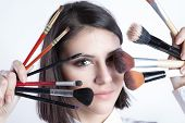 image of stippling  - Beauty girl with makeup brushes - JPG