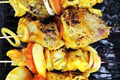 pic of charcoal  - fresh raw roast shish kebab on barbecue grill grid coocked over hot charcoal - JPG