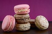 pic of marsala  - Delicious strawberry and chocolate macaroons on wood and marsala color background - JPG