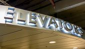 picture of elevators  - a lit elevator sign of aluminum letters - JPG