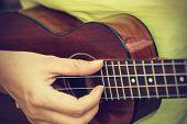 picture of ukulele  - Woman playing ukulele vintage style - JPG