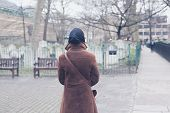 picture of graveyard  - A woman is walking around a graveyard - JPG