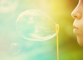 foto of lip  - Child blowing bubbles - JPG