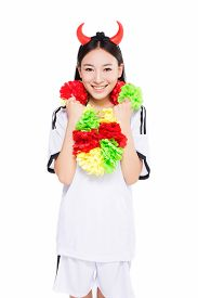 stock photo of pom poms  - asian happy cheerleader holding pom - JPG