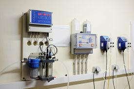 stock photo of disinfection  - Automatic station water disinfection in swimming pool - JPG