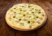 image of leek  - Delicious seafood pizza with tuna fish olives and leek  - JPG
