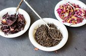 picture of rose bud  - Rose bud tea in the vintage spoons on the black stone desk - JPG