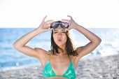 pic of watersports  - Woman on beach vacation having fun with snorkeling mask - JPG