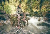 picture of survival  - Young Man bearded relaxing hiking outdoor with river and forest wild on background Lifestyle Travel survival concept - JPG