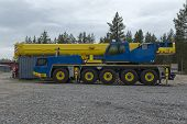 foto of boom-truck  - An industrial crane parked on a open space - JPG