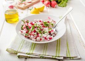 pic of radish  - Radish Spring salad with herbs fresh and delicious dressing from olive oil pepper salt and lemon juice and zest - JPG