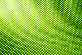 picture of nylons  - green fabric nylon background texture with light from corner - JPG