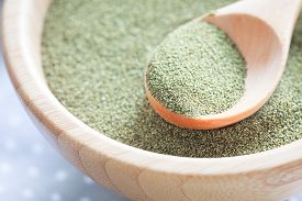 foto of algae  - Kelp (algae) green powder , healtly superfood. ** Note: Shallow depth of field - JPG