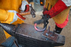 foto of anvil  - Process of forging iron red - JPG