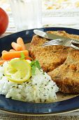 foto of pork chop  - A baked pork chop with rice and carrot - JPG