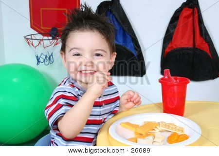Adorable Preschooler Eating Snacks poster
