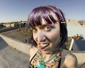 Cute Young Woman On A Roof Sticking Out Her Tongue