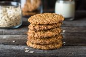 Homemade Oatmeal Cookies On Wooden Board On Old Table Background. Healthy Food Snack Concept. Copy S poster