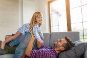 Father Playing with Daughter At Home  poster