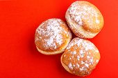 Tasty Sweet Donuts With Powdered Sugar On Bright Red Background. Traditional Jewish Sweet Hanukkah D poster
