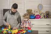 Father And Small Child Play With Constructor. Little Boy Play With Father At Home. Happy Family And  poster