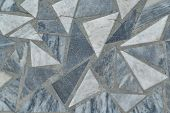 The Surface Of The Floor Or Wall Is Made Of Marble Tiles In The Form Of Triangles And Polygon. The S poster