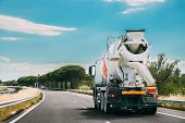 Special Concrete Transport Truck In-transit Mixer Unit In Motion On Country Road, Freeway. Freeway M poster