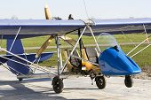 picture of ultralight  - old and open ultra light plane standing on airway - JPG