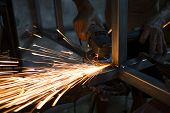 Worker Steel Welding In Workspace. Sparks From Welding Steel. poster