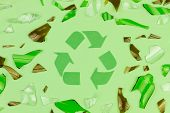 Green Recycle Sign Symbol With Shattered Glass Trash Garbage Bottle, Pills And Tubes On Green Isolat poster