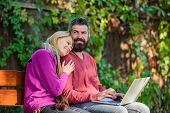Couple In Love Notebook Consume Content. Internet Surfing Concept. Couple With Laptop Sit Bench In P poster