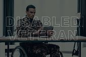 Military Veteran. Disabled Man In A Wheelchair. Man Sitting At Table. Man Using Tablet Pc. Man Is So poster