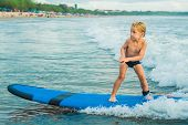 Little Boy Surfing On Tropical Beach. Child On Surf Board On Ocean Wave. Active Water Sports For Kid poster